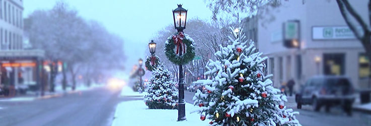 Main Street on Wellsboro decorated and covered in snow for Christmas celebrations