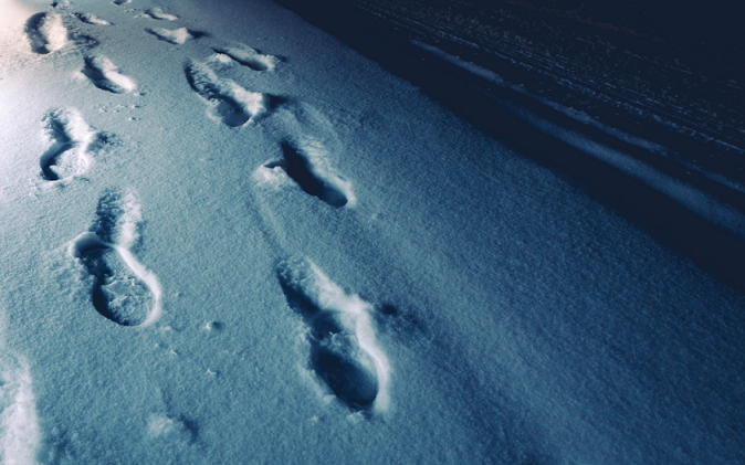 Footprints in the snow at night