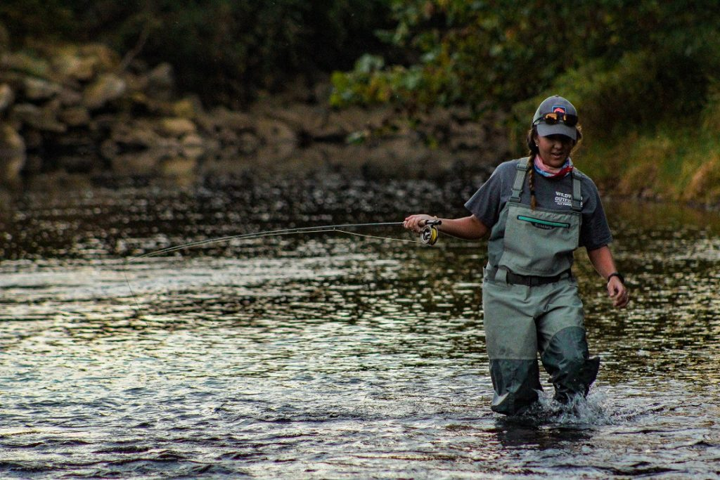 Woman fly fishing with Wildwood Outfitters